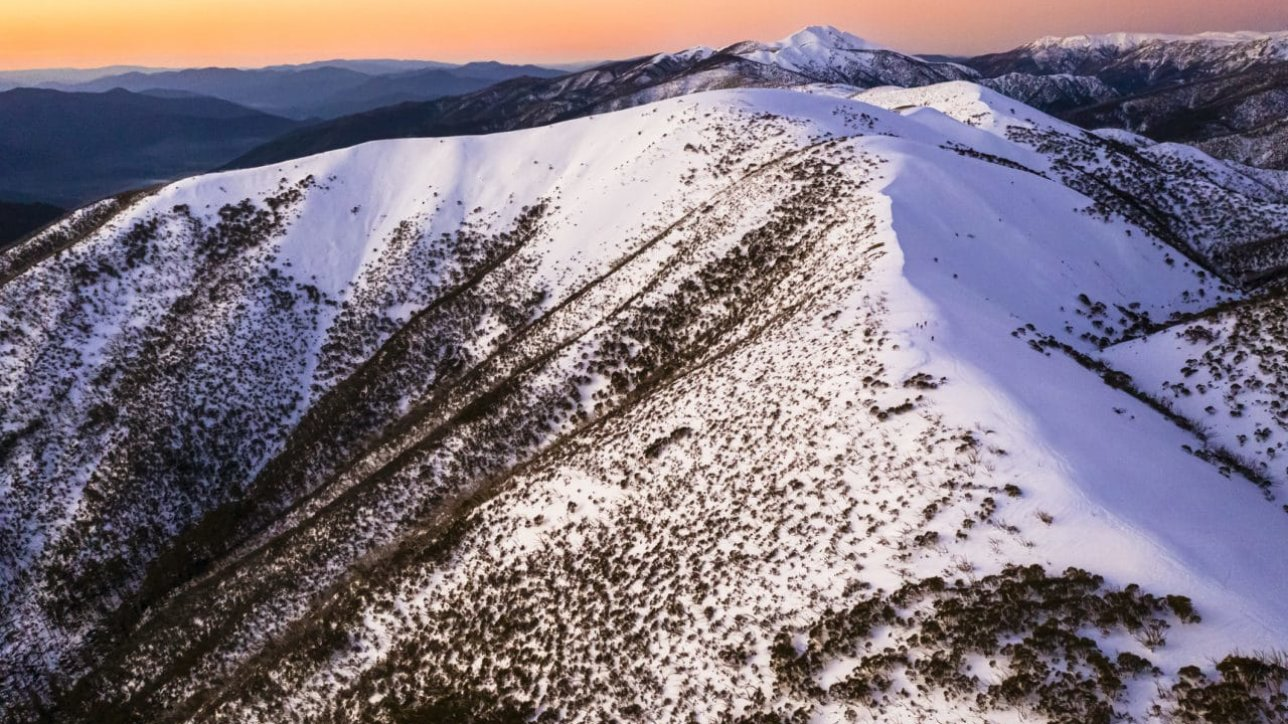 Razorback Hiking Trailhead at Mt. Hotham Victoria Australia, at dusk / sunset with snow.